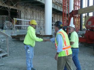 three construction worker talking on construction site