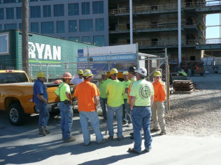 large group of construction workers in neon colors and hardhats